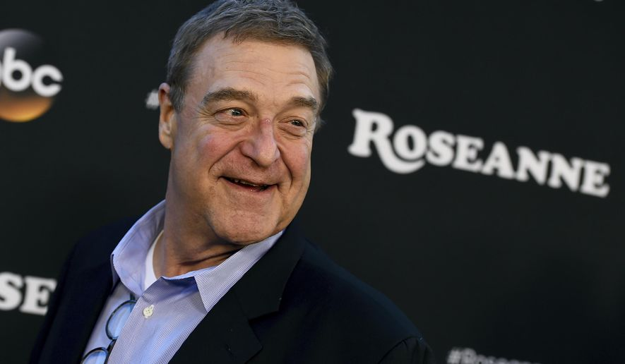 """FILE - In this March 23, 2018, file photo, John Goodman arrives at the Los Angeles premiere of """"Roseanne"""" in Burbank, Calif. Cast members of the """"Roseanne"""" revival are looking forward to their spinoff """"The Conners."""" Goodman, Sara Gilbert and Laurie Metcalf discuss Roseanne Barr's racist tweet in a story that will appear in the Oct. 15 edition of People magazine. (Photo by Jordan Strauss/Invision/AP, File)"""