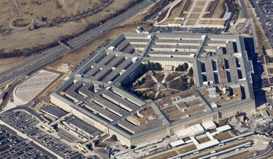 In this Feb. 12, 2009, file photo, the Pentagon is seen from Air Force One. (AP Photo/Charles Dharapak, File)
