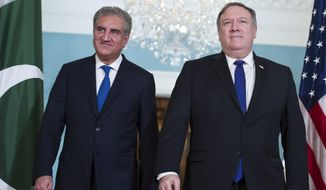Secretary of State Mike Pompeo, right, meets Pakistani Foreign Minister Makhdoom Shah Mahmood Qureshi at the State Department in Washington, Tuesday, Oct. 2, 2018. (AP Photo/Cliff Owen)