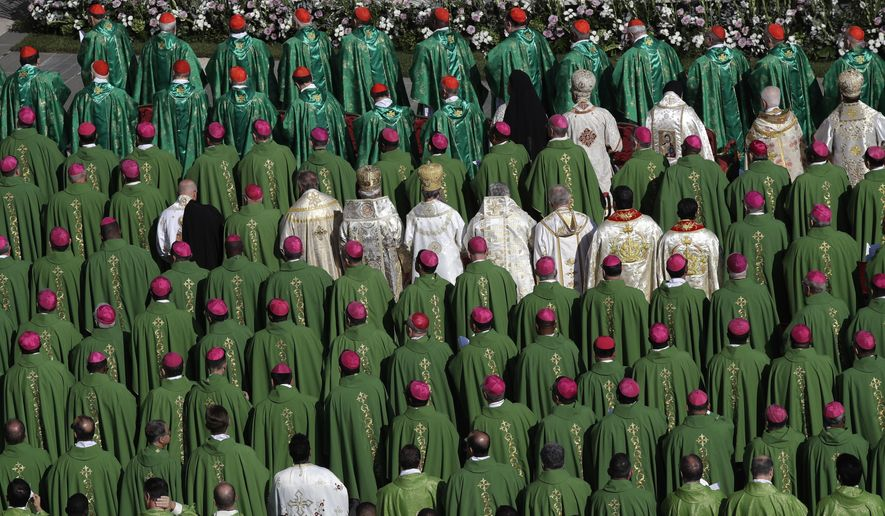 Bishops and Cardinals attend a Mass celebrated by Pope Francis for the opening of a synod, a meeting of bishops, in St. Peter's Square, at the Vatican, Wednesday, Oct. 3, 2018. The synod is bringing together 266 bishops from five continents for talks on helping young people feel called to the church at a time when church marriages and religious vocations are plummeting in much of the West. (AP Photo/Alessandra Tarantino)