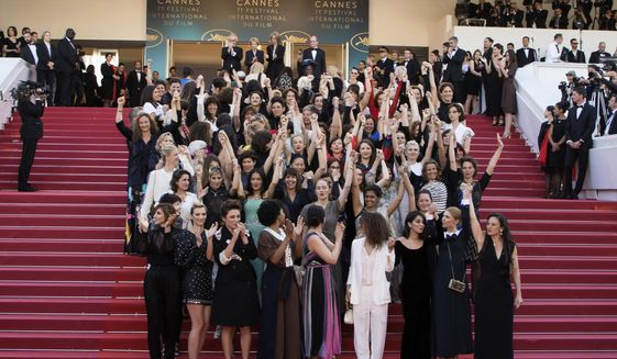 In this May 12, 2018, file photo, 82 film industry professionals stand on the steps of the Palais des Festivals to represent, what they describe as pervasive gender inequality in the film industry, at the Cannes Film Festival in Cannes, France. The #MeToo movement has gone far beyond the movies, but Hollywood remains ground zero in a cultural eruption that began 12 months ago with the revelations about Harvey Weinstein. (Photo by Vianney Le Caer/Invision/AP, File)