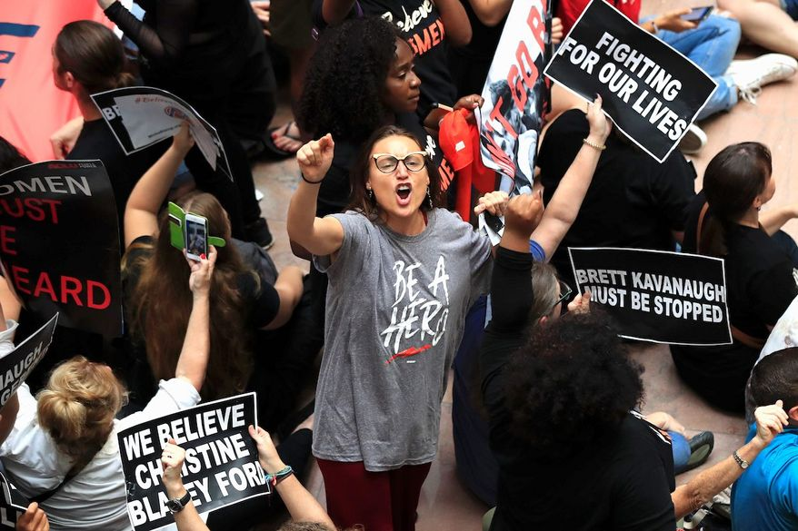 Demonstrators chant slogans on Capitol Hill to protest Supreme Court nominee Brett M. Kavanaugh. A national rally is planned for Saturday. (Associated Press)