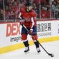 Washington Capitals center Evgeny Kuznetsov (92), of Russia, skates with the puck during the first period of an NHL preseason hockey game against the St. Louis Blues, Sunday, Sept. 30, 2018, in Washington. (AP Photo/Nick Wass) **FILE**