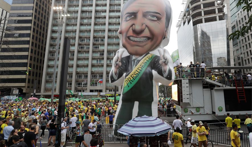 A large, inflatable doll of presidential candidate Jair ...