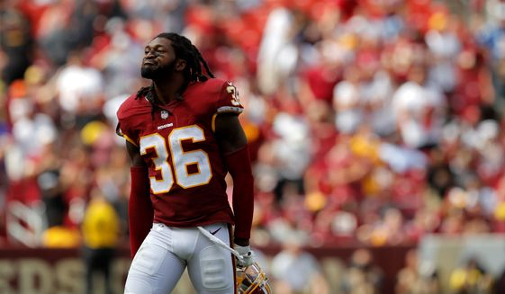 """GEtting tough: """"The game wasn't designed to play tag,"""" Washington Redskins safety D.J. Swearinger said. """"The game was designed to hit people."""" (Associated Press)"""