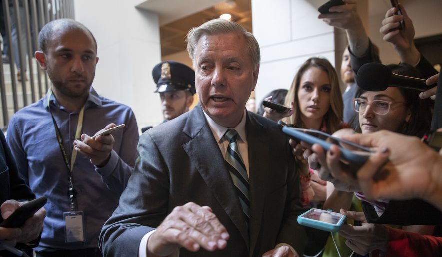 Sen. Lindsey Graham, R-S.C.,  a member of the Senate Judiciary Committee, responds to reporters outside a secure underground room in the Capitol where senators are being briefed on a new FBI background file on sexual allegations that have been made against Supreme Court nominee Brett Kavanaugh, in Washington, Wednesday, Oct. 3, 2018. (AP Photo/J. Scott Applewhite) ** FILE **