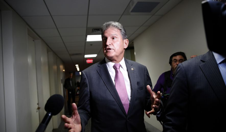 Sen. Joe Manchin, D-W.Va., heads to his office, on Capitol Hill, Thursday, Oct. 4, 2018, in Washington. (AP Photo/Alex Brandon) ** FILE **