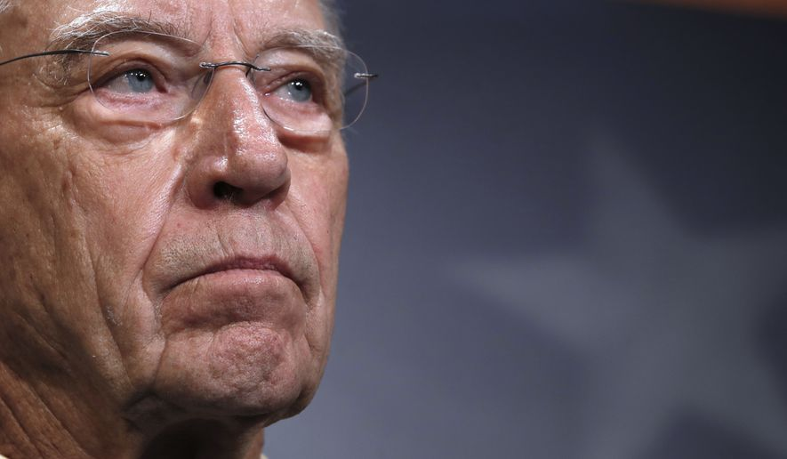 Senate Judiciary Committee Chairman Sen. Chuck Grassley, R-Iowa, attends a news conference about the FBI investigation of Supreme Court nominee Brett Kavanaugh, Thursday, Oct. 4, 2018, on Capitol Hill in Washington. (AP Photo/Jacquelyn Martin)