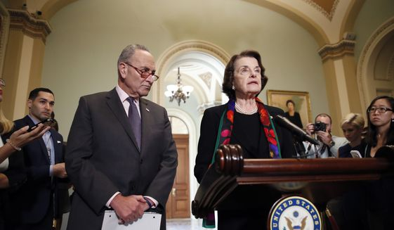 Senate Judiciary Committee Ranking Member Sen. Dianne Feinstein, D-Calif., speaks to the media, accompanied by Senate Minority Leader Chuck Schumer, D-N.Y., about the FBI report on sexual misconduct allegations against Supreme Court nominee Brett Kavanaugh, on Capitol Hill, Thursday, Oct. 4, 2018 in Washington. (AP Photo/Alex Brandon) ** FILE **
