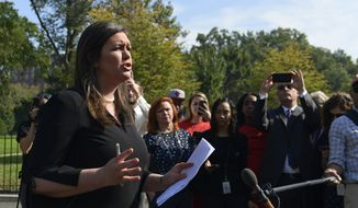 White House press secretary Sarah Huckabee Sanders talks to reporters about the FBI investigation of Supreme Court nominee Brett Kavanaugh outside the West Wing of the White House in Washington, Thursday, Oct. 4, 2018. (AP Photo/Susan Walsh)