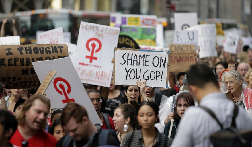 Protesters march to Times Square in New York, Thursday, Oct. 4, 2018. Hundreds of people rallied in front of Trump Tower then walked to Times Square to protest Supreme Court nominee Brett Kavanaugh. (AP Photo/Seth Wenig)