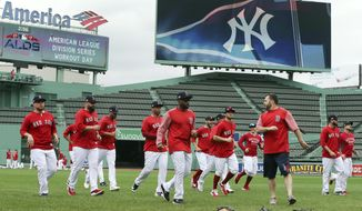 Boston Red Sox players warm up during a baseball workout at Fenway Park, Thursday, Oct. 4, 2018, in Boston, in preparation for Game 1 of the ALDS against the New York Yankees on Friday. (AP Photo/Elise Amendola)