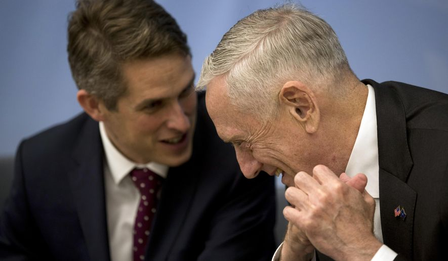 U.S. Secretary for Defence Jim Mattis, right, talks to Britain's Defence Minister Gavin Williamson before a signing ceremony following a meeting of NATO defence ministers at NATO headquarters in Brussels, Wednesday, Oct. 3, 2018. (AP Photo/Francisco Seco, Pool)