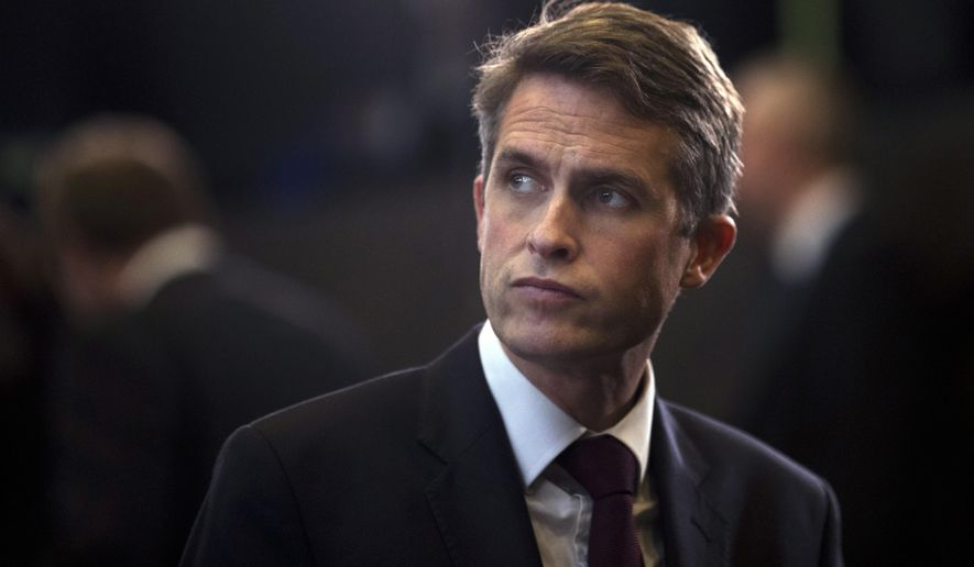 """Britain's Defence Minister Gavin Williamson stands in the main chamber during the second day of a meeting of the North Atlantic Council at a gathering of NATO defence ministers at NATO headquarters in Brussels, Thursday, Oct. 4, 2018. British Defence Secretary Gavin Williamson on Thursday branded a series of global cyberattacks blamed on Russia as the reckless actions of a """"pariah state"""" and said that Britain and its NATO allies would expose such actions in the future. (AP Photo/Francisco Seco)"""