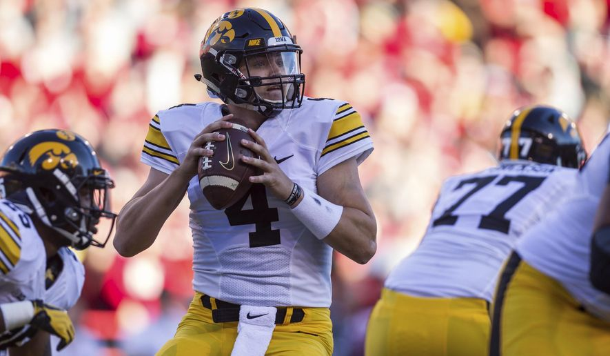 FILE - In this Nov. 24, 2017, file photo, Iowa quarterback Nate Stanley (4) drops back to pass against Nebraska during the first half of an NCAA college football game, in Lincoln, Neb.  Iowa (3-1, 0-1 Big Ten) has won nine straight when scoring 20 or more points, and the combo of QB Nate Stanley and TE Noah Fant will be a big chore for Minnesota's defense.(AP Photo/John Peterson, File)
