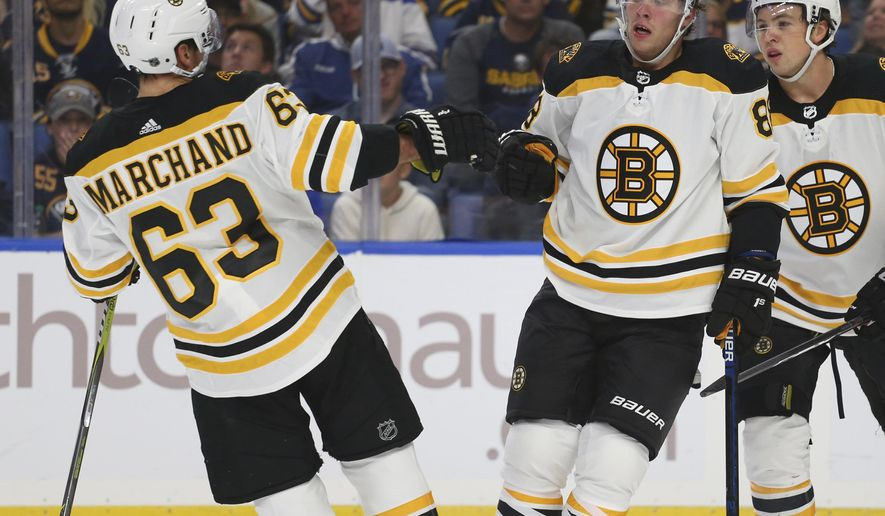 Boston Bruins forwards Brad Marchand (63) and David Pastrnak (88) celebrate a goal during the second period of the team's NHL hockey game against the Buffalo Sabres, Thursday, Oct. 4, 2018, in Buffalo N.Y. (AP Photo/Jeffrey T. Barnes)