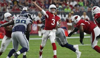 FILE - In this Sept. 30. 2018, file photo, Arizona Cardinals quarterback Josh Rosen throws against the Seattle Seahawks during the first half of an NFL football game in Glendale, Ariz. San Francisco coach Kyle Shanahan took only a cursory look at Rosen in his draft preparation last spring since the 49ers already had franchise quarterback Jimmy Garoppolo in place. Shanahan studied Rosen a lot more closely this week after he made his first career start in the NFL because now he has to face him when the Arizona Cardinals visit the 49ers. (AP Photo/Rick Scuteri, File)