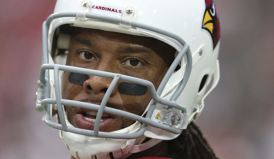 FILE - In this Sunday, Sept. 23, 2018, file photo, Arizona Cardinals wide receiver Larry Fitzgerald pauses on the field prior to an NFL football game against the Chicago Bears in Glendale, Ariz. Fitzgerald says it's the wins that keep him playing in the NFL. If that's true, it must have been a pretty miserable first month to his 15th pro season. (AP Photo/Ralph Freso, FIle)