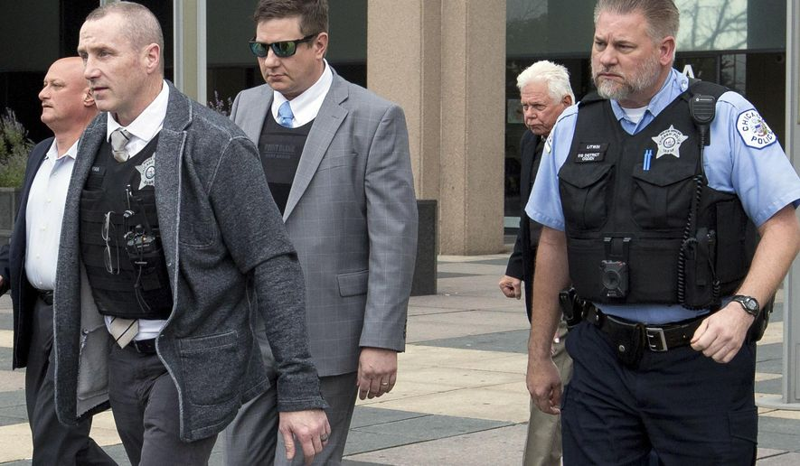Chicago Police Officer Jason Van Dyke, wearing sunglasses, is escorted out of the Leighton Criminal Court Building in Chicago, Tuesday, Oct. 2, 2018, after testifying in his first degree murder trial for the shooting death of Laquan McDonald. (AP Photo/Teresa Crawford)