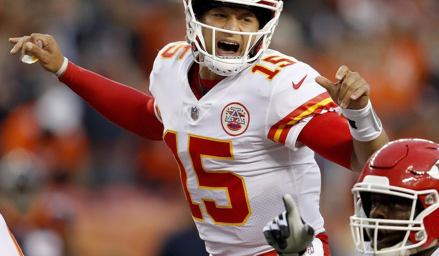 """FILE - In this Oct. 1, 2018, file photo, Kansas City Chiefs quarterback Patrick Mahomes (15) makes a call against the Denver Broncos during the first half of an NFL football game, in Denver. Chiefs wide receiver Tyreek Hill called his quarterback slow. Their coach, Andy Reid, said his quarterback's voice was """"froggish."""" And Patrick Mahomes insists he can dish the trash talk just as well as he can receive it. It's all part of a unique locker-room banter that has helped keep things light as Kansas City rolls up win after win. (AP Photo/David Zalubowski, File)"""