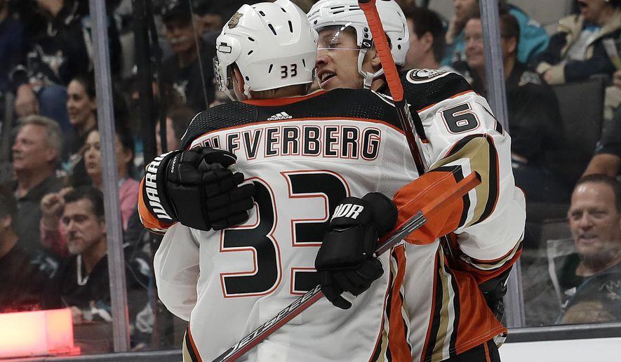 Anaheim Ducks center Rickard Rakell, right, from Sweden, celebrates with right wing and countryman Jakob Silfverberg (33) after Rakell scored a goal against the San Jose Sharks during the second period of an NHL hockey game in San Jose, Calif., Wednesday, Oct. 3, 2018. (AP Photo/Jeff Chiu)