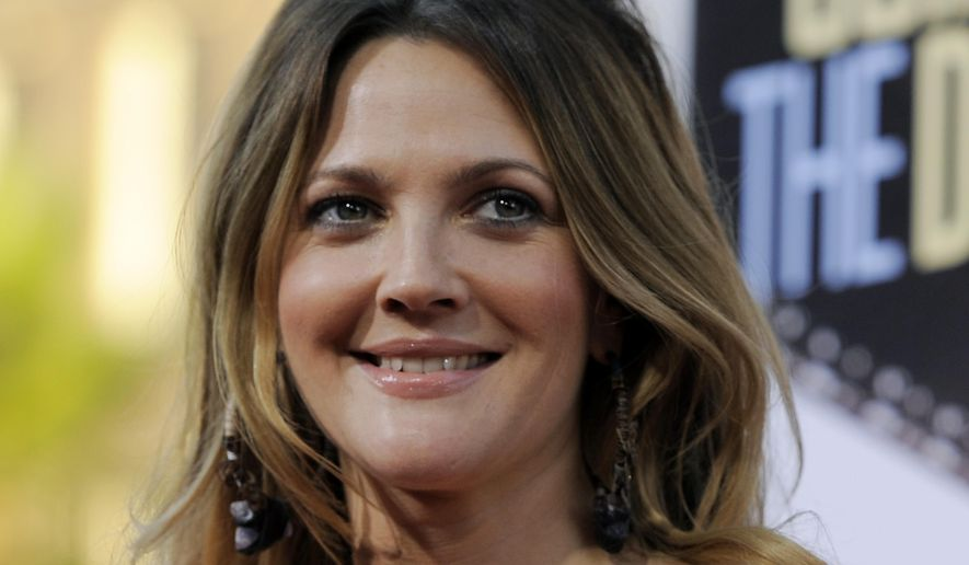 "In this Monday, Aug. 23, 2010, file photo, Drew Barrymore, a cast member in ""Going the Distance,"" arrives at the premiere of the film in Los Angeles. EgyptAir is standing by a writer for its in-flight magazine who penned a bizarre article purportedly based on an interview with American actress Drew Barrymore. (AP Photo/Chris Pizzello, File)"