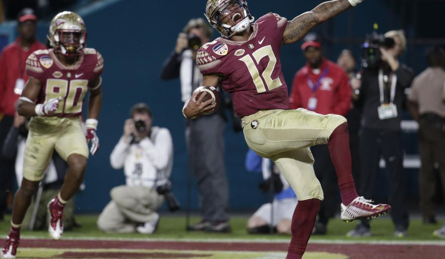 FILE - In this Dec. 30, 2016, file photo, Florida State quarterback Deondre Francois (12) celebrates after scoring a touchdown during the second half of the Orange Bowl NCAA college football game against Michigan,  in Miami Gardens, Fla. At left is Florida State wide receiver Nyqwan Murray (80). Florida State quarterback Deondre Francois has already won two starts on Miami's home field. That's one more than Miami's starter has.It's a statistical oddity, but it's true. (AP Photo/Lynne Sladky, File)