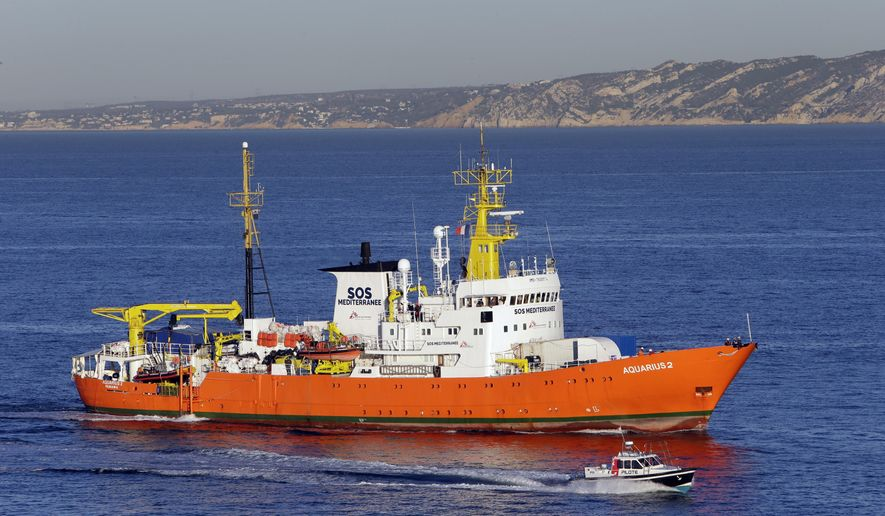 """The Aquarius arrives at Marseille port, southern France, Thursday, Oct.4, 2018. Humanitarian group SOS Mediterranee said Thursday the Aquarius is making a stopover while waiting for a new flag and is """"determined to go back to sea as soon as possible."""" The group urged European government to find a new flag for the vessel to secure its future after Panama's maritime authority removed the registration of the boat. (AP Photo/Claude Paris)"""