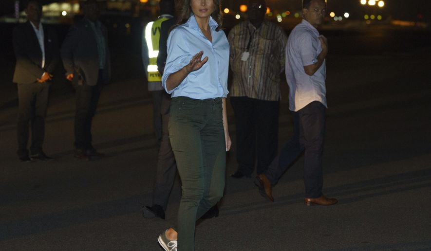 First lady Melania Trump boards a plane at Kotoka International Airport in Accra, Ghana, Thursday, Oct. 4, 2018. First lady Melania Trump is visiting Africa on her first big solo international trip. (AP Photo/Carolyn Kaster)