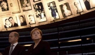 German Chancellor Angela Merkel visits the Hall of Names in the Yad Vashem Holocaust Museum in Jerusalem, Israel, Thursday Oct. 4, 2018. (Debbie Hill/Pool via AP)