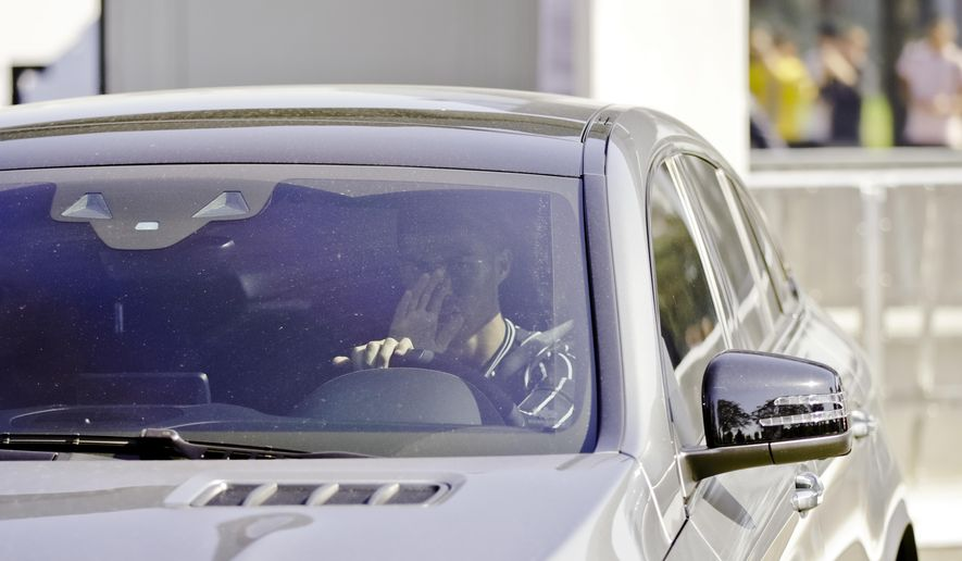 Juventus' Cristiano Ronaldo drives his car as he leaves after completing a training session at the Juventus center in Turin, Italy, Thursday, Oct. 4, 2018. Lawyers for a Nevada woman who has accused Cristiano Ronaldo of raping her say a psychiatrist determined she suffers post-traumatic stress and depression because of the alleged 2009 attack in Las Vegas. (AP Photo/Luca Bruno)