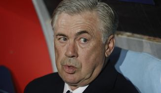 Napoli coach Carlo Ancelotti sits on the bench prior to the Champions League, group C soccer match between Napoli and Liverpool, at the San Paolo Stadium in Naples, Italy, Wednesday, Oct. 3, 2018. (AP Photo/Andrew Medichini)