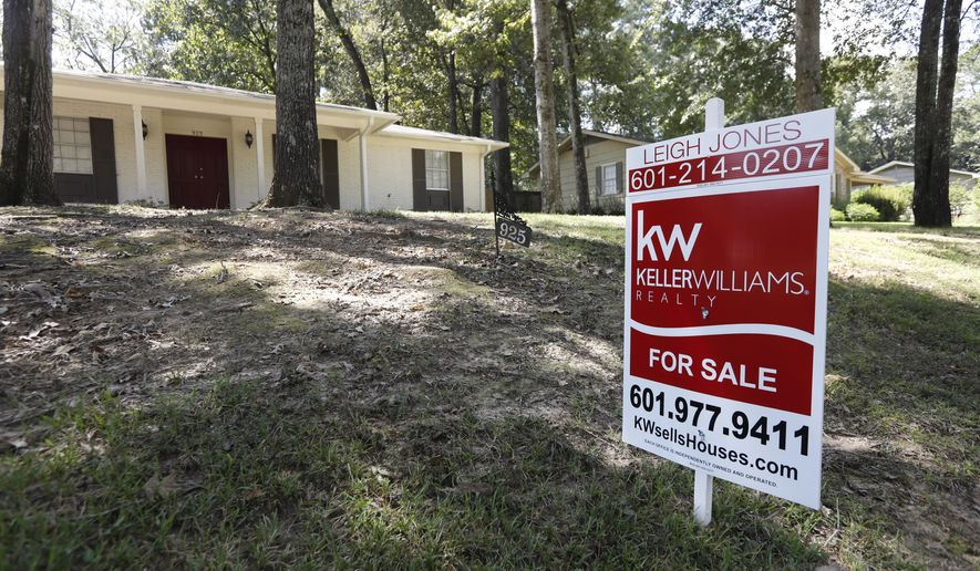 This Sept. 21, 2018 photo shows a for sale sign in front of a home in north Jackson, Miss. On Thursday, Oct. 4, Freddie Mac reports on the week's average U.S. mortgage rates. (AP Photo/Rogelio V. Solis)