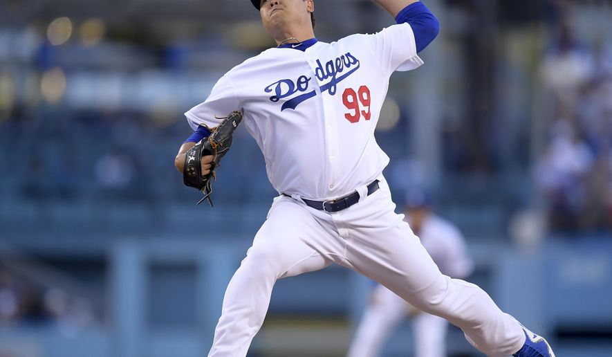 Los Angeles Dodgers starting pitcher Hyun-Jin Ryu throws to an Atlanta Braves batter during the first inning of Game 1 of a baseball National League Division Series, Thursday, Oct. 4, 2018, in Los Angeles. (AP Photo/Mark J. Terrill)