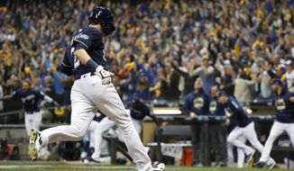 Milwaukee Brewers' Christian Yelich scored the game-winning run during the 10th inning of Game 1 of the National League Divisional Series baseball game against the Colorado Rockies Thursday, Oct. 4, 2018, in Milwaukee. The Brewers won 3-2 to take a 1-0 lead in the series. (AP Photo/Jeff Roberson)