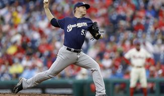 FILE - In this June 10, 2018, file photo, Milwaukee Brewers' Brandon Woodruff pitches during the third inning of a baseball game against the Philadelphia Phillies, in Philadelphia.  Woodruff not only made the Milwaukee Brewers' playoff roster, but he's starting Game 1 of the National League Division Series against the Colorado Rockies.(AP Photo/Matt Slocum, File)