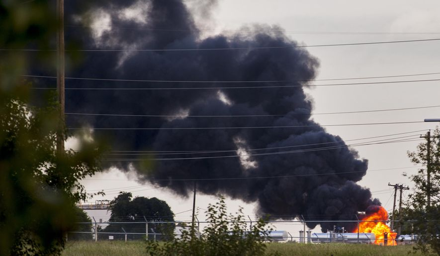 Smoke fills the air as a insulated tank that contains 7000 gallons of heating oil and glycerol burns after catching fire at the OG&E Power plant near NW 10th St. in Oklahoma City, Okla. on Thursday, Oct. 4, 2018. Area businesses were evacuated by the fire department as a safety measure. (Chris Landsberger/The Oklahoman via AP)