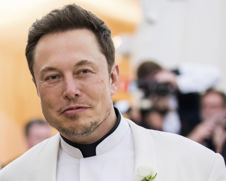 FILE - In this May 7, 2018, file photo, Elon Musk attends The Metropolitan Museum of Art's Costume Institute benefit gala celebrating the opening of the Heavenly Bodies: Fashion and the Catholic Imagination exhibition in New York. Tesla CEO  Musk is apparently taunting the government agency that accused him of duping investors just days after negotiating a settlement to keep his job. (Photo by Charles Sykes/Invision/AP, File)