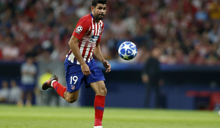Atletico forward Diego Costa eyes the ball during a Group A Champions League soccer match between Atletico Madrid and Club Brugge at the Wanda Metropolitano stadium in Madrid, Spain, Wednesday Oct. 3, 2018. (AP Photo/Paul White)