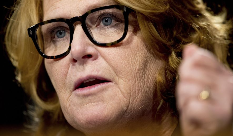 Sen. Heidi Heitkamp, D-N.D., testifies in front of the Senate Banking Committee in Washington. Heitkamp, one of the few Democratic senators who'd been undecided on the Supreme Court nominee Brett Kavanaugh, tells a television station she will vote against Kavanaugh. (AP Photo/Andrew Harnik, File)