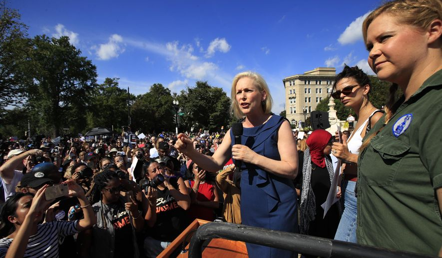 Sen. Kirsten Gillibrand, D-N.Y., with actress and comedian Amy Schumer, right, speaks at a rally against Supreme Court nominee Brett Kavanaugh at the Supreme Court in Washington, Thursday, Oct. 4, 2018. (AP Photo/Manuel Balce Ceneta)