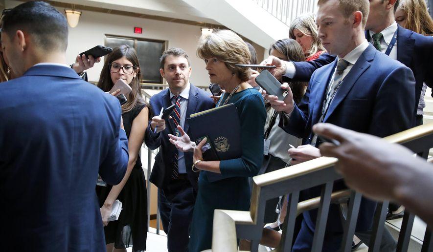 Sen. Lisa Murkowski, R-Alaska, arrives to view the FBI report on sexual misconduct allegations against Supreme Court nominee Brett Kavanaugh, on Capitol Hill, Thursday, Oct. 4, 2018 in Washington. (AP Photo/Alex Brandon)