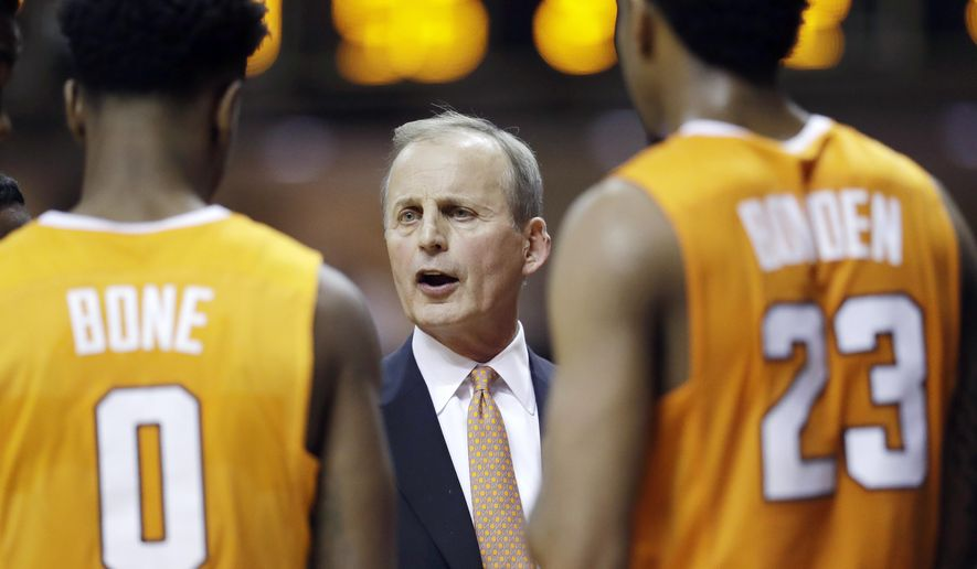FILE - In this Jan. 9, 2018, file photo, Tennessee coach Rick Barnes talks with Jordan Bone (0) and Jordan Bowden (23) during a timeout in the second half of an NCAA college basketball game against Vanderbilt in Nashville, Tenn. Barnes says Vols won't get complacent as they return the nucleus of the team that won a share of SEC regular-season title last year.  (AP Photo/Mark Humphrey, File)