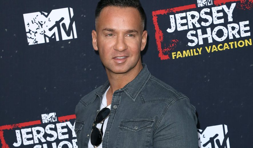 """FILE - In this March 29, 2018 file photo, Mike """"The Situation"""" Sorrentino arrives at the """"Jersey Shore Family Vacation"""" premiere in Los Angeles.  Sorrentino is seeking probation when he's sentenced Friday on tax charges, while prosecutors want a sentence of 14 months. Sorrentino pleaded guilty in January to concealing his income in 2011 by making cash deposits that wouldn't trigger federal reporting requirements. He and his brother were charged in 2014 with multiple tax offenses related to nearly $9 million in income. (Photo by Willy Sanjuan/Invision/AP, File)"""
