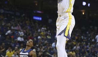 Golden State Warriors' Kevin Durant, right, scores against the Minnesota Timberwolves in the second half of an NBA preseason basketball game Saturday, Sept. 29, 2018, in Oakland, Calif. (AP Photo/Ben Margot)