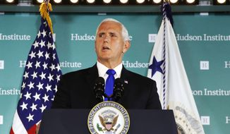 """Vice President Mike Pence speaks Thursday, Oct. 4, 2018, at the Hudson Institute in Washington. Pence said China was using its power in """"more proactive and coercive ways to interfere in the domestic policies and politics of the United States.""""  (AP Photo/Jacquelyn Martin)"""