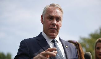 In this Aug. 16, 2018, file photo, Interior Secretary Ryan Zinke speaks to members of the media outside the White House in Washington, D.C. Zinke has scheduled a visit, Monday, Oct. 8, to Montana, where he's expected to finalize a proposal to block new mining claims on the forested public lands just outside Yellowstone National Park. (AP Photo/Pablo Martinez Monsivais, file)
