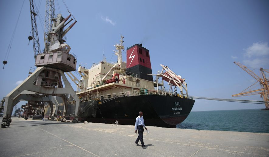 In this Saturday, Sept. 29, 2018 photo, a cargo ship is docked at the port, in Hodeida, Yemen. With US backing, the United Arab Emirates and its Yemeni allies have restarted their all-out assault on Yemen's port city of Hodeida, aiming to wrest it from rebel hands. Victory here could be a turning point in the 3-year-old civil war, but it could also push the country into outright famine. Already, the fighting has been a catastrophe for civilians on the Red Sea coast. (AP Photo/Hani Mohammed)