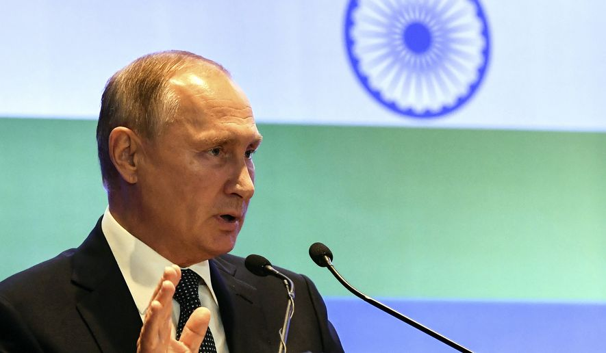 Russian President Vladimir Putin attends a Russian-Indian business summit session in New Delhi, India, Friday, Oct. 5, 2018. India has signed a $5 billion deal to buy 5 Russian S-400 air defense systems despite a looming threat of U.S. sanctions on countries that trade with Russia's defense and intelligence sectors. (Yuri Kadobnov/Pool Photo via AP)