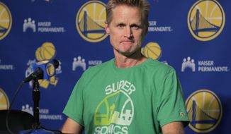 Golden State Warriors coach Steve Kerr wears a Seattle SuperSonics T-shirt as he listens to a question during a news conference before the team's NBA preseason basketball game against the Sacramento Kings on  Friday, Oct. 5, 2018, in Seattle. (AP Photo/Ted S. Warren) ** FILE **